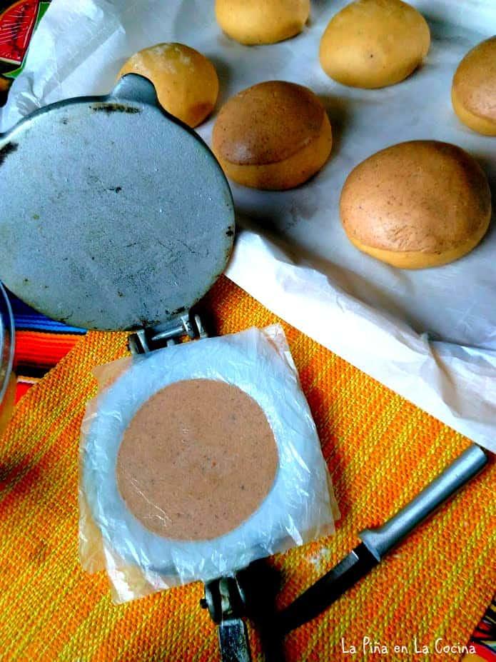 Tortilla press used to flatten sugar topping