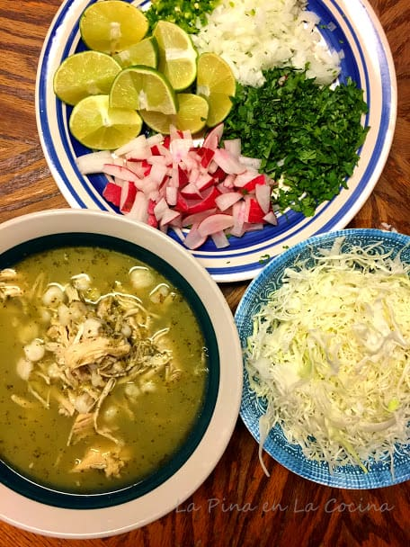 pozole and garnishes in separate bowls