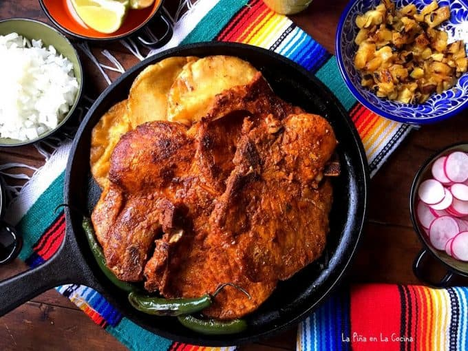 chuletas marinated in adobo for al pastor cooked and plated