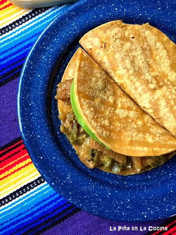 Chicharron in Salsa Verde Tacos on a blue plate #chicharron #salsaverde
