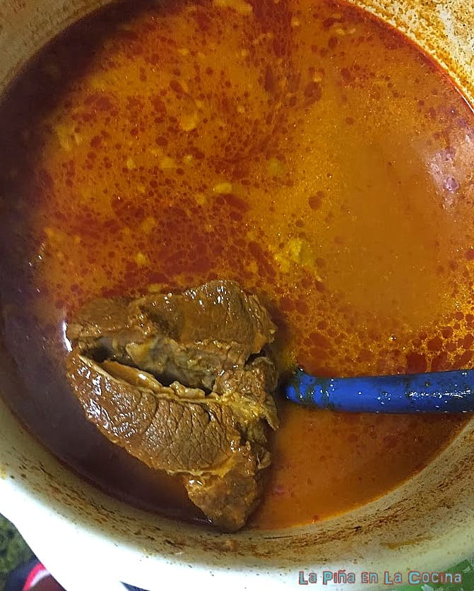 Beef cooking in consomme