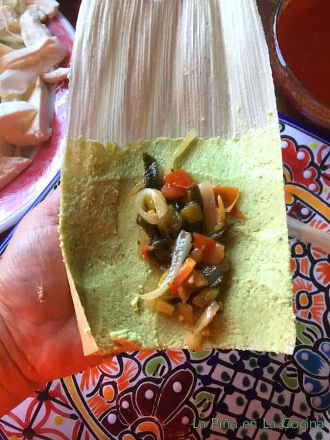 open corn husk with masa ans vegetable filling