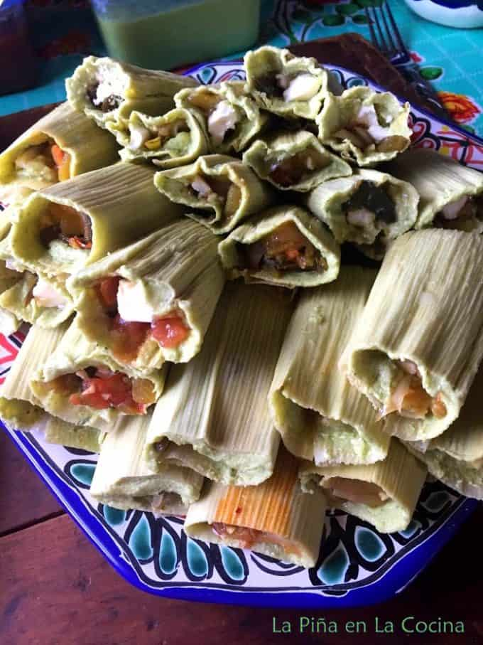 Tamales Verdes filled and stacked on a plate