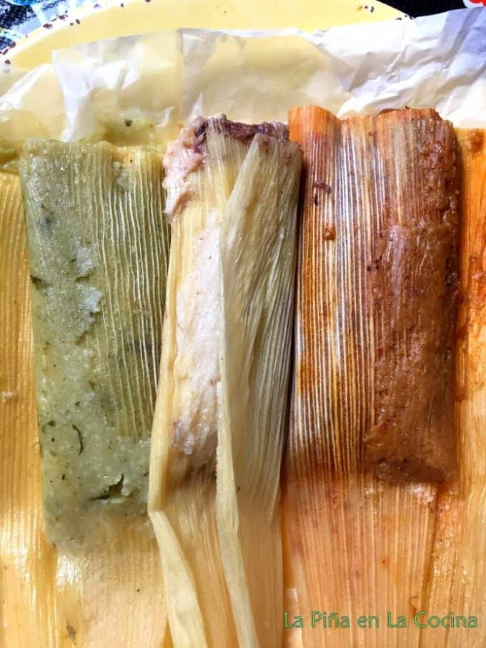 Three variations of tamal hot out of steamer pot