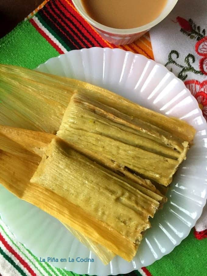 Green chile tamales plated unwrapped
