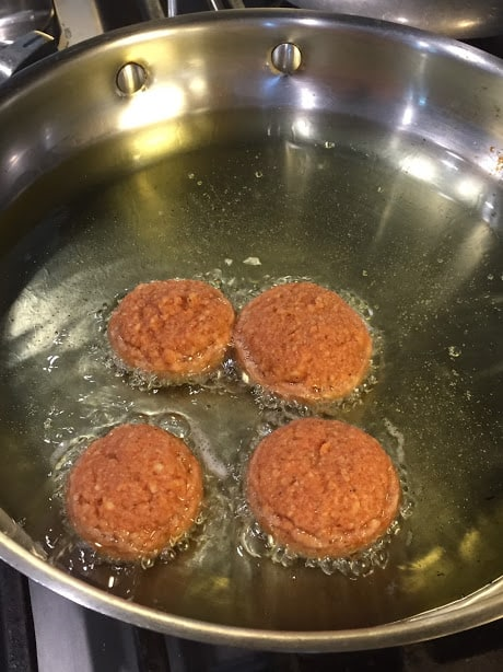 Tortitas de Camaron Seco- Dried Shrimp Cakes. Shrimp cakes frying in preheated grapeseed oil.