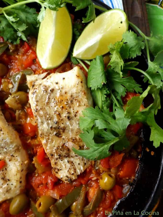 Single shot of fish in pan with sauce
