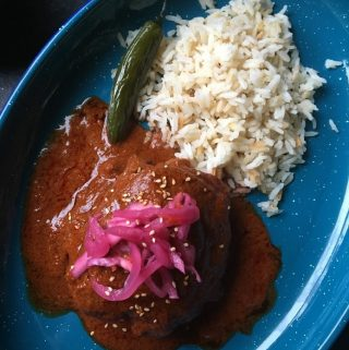 Red Chicken Pipian Plated with Rice and Serrano Pepper