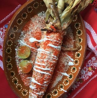 Grilled Elote Garnished on a plate