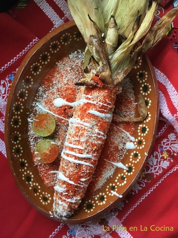 Grilled elote with all the toppings plared