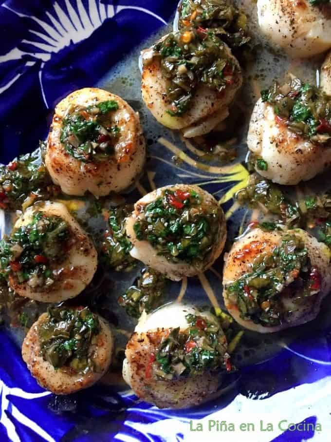 Seared Scallops garnished with chimichurri on a Platter