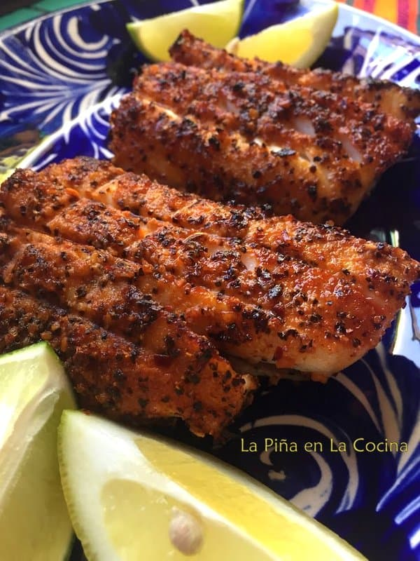 Grilled sablefish(black cod) plated with lemon wedges