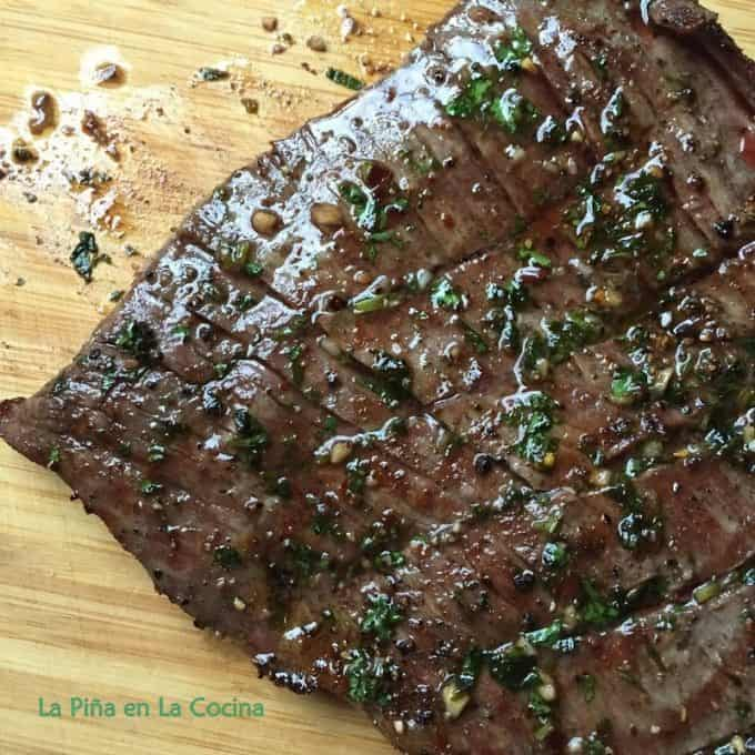 Steak resting on wooden cutting board