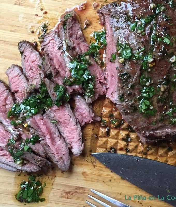 Grilled Flank Steak with cilantro Mojo Sliced on board