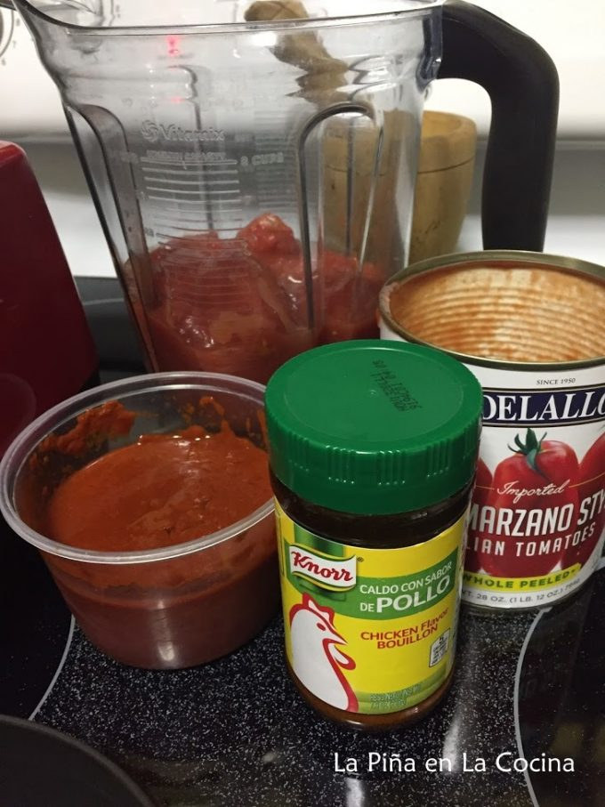 Ingredients for the red sauce, chile sauce, whole tomatoes and chicken bouillon powder
