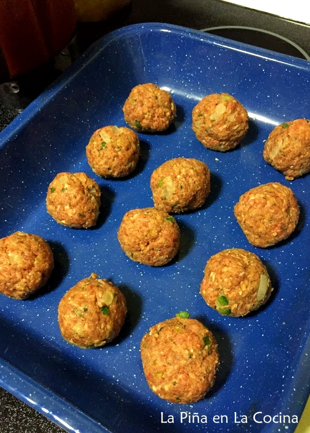 Uncooked meatballs formed in a baking dish