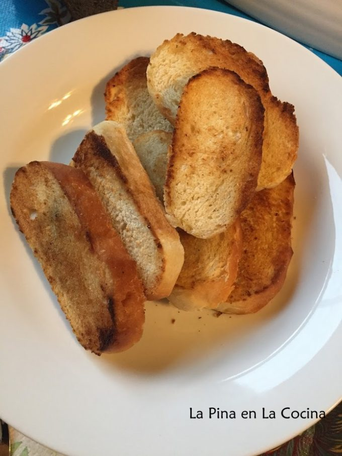 Quick garlic bread slices toasted in a shallow bowl