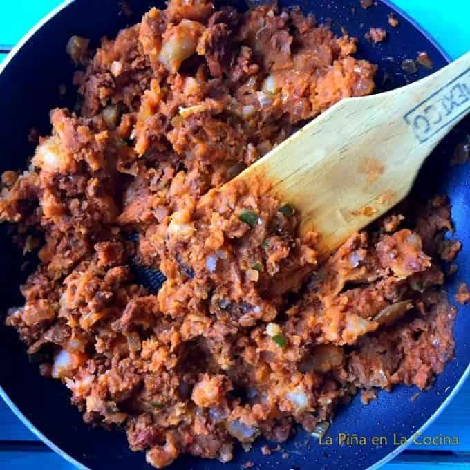 Chorizo potato mix in skillet ready to assemble pambazo