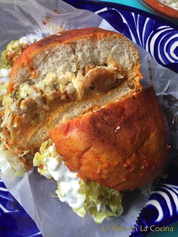 Pambazo sandwich sliced in half