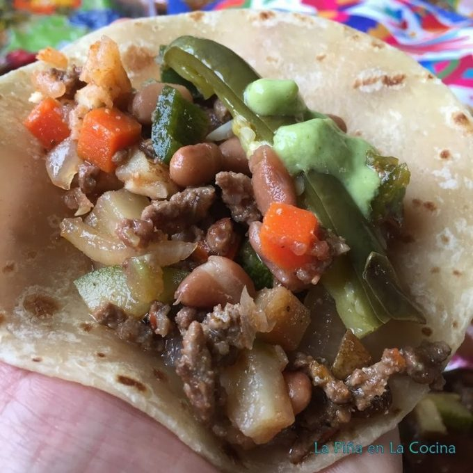 Picadillo taco on flour tortilla