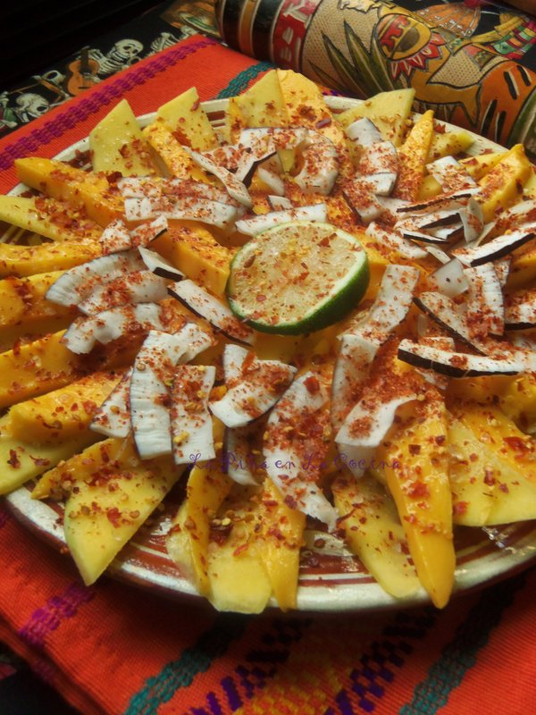 Pineapple, Mango, coconut fruit platter with lime juice, salt and crushed chile piquin