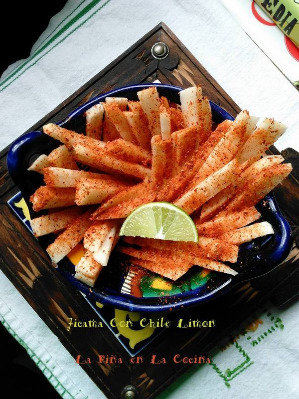 Jicama sticks seasoned with chile limon powder and lime