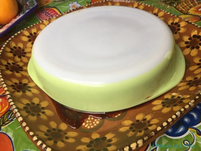 Flan turned upside down on Mexican platter before unmolding