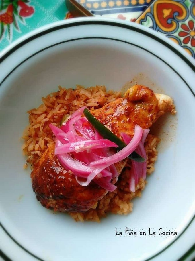 Beer Can Chicken garnished with pickled red onions