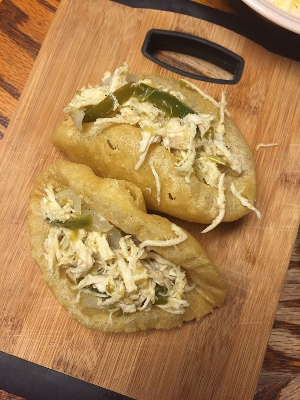 Puffy Taco shells filled with chicken in salsa
