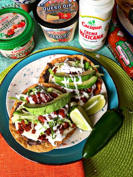 two tostadas morelianas plated with Cacique products on the table