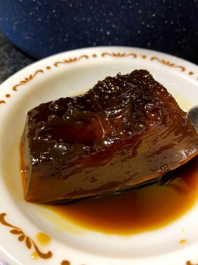 Wedge of cooked pumpkin in syrup