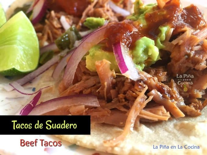 Beef suadero taco close up with text
