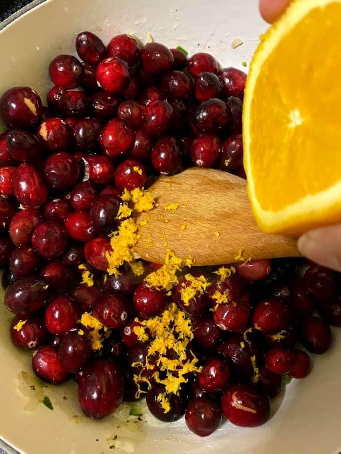 Adding orange juice to fresh cranberries
