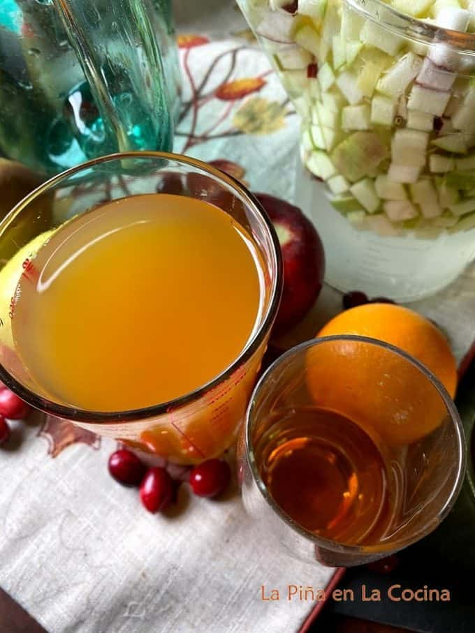 Apple cider and apple brandy measured out for sangria