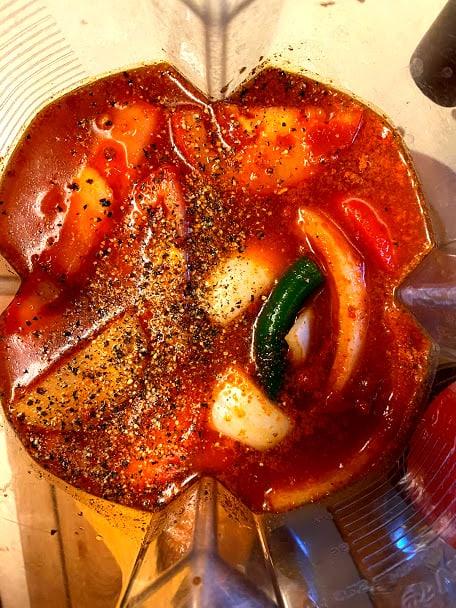 Red salsa ingredients in the blender jar