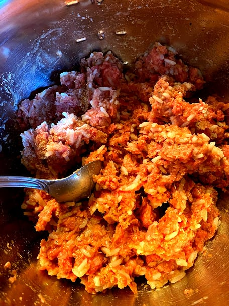 Uncooked ground beef with rice, eggs and spices