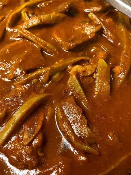 Beef ribs and cactus simmering in salsa close up