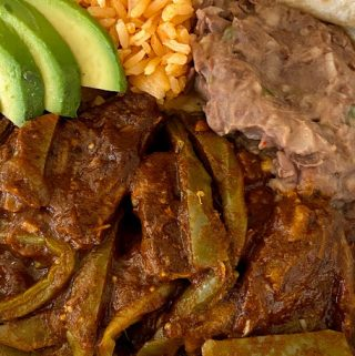 Beef ribs with cactus served with rice and beans and avocado(Costillas Con Nopalitos en Salsa)
