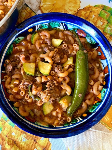 Close up, top view of bowl of coditos con carne