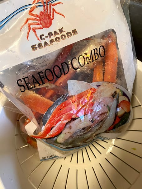A variation of frozen seafood combo c-pak seafoods brand