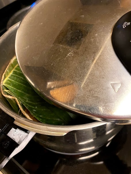 Covering the pressure cooker with lid