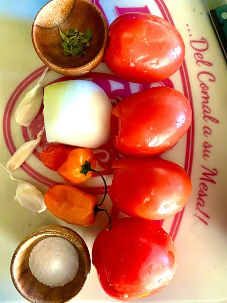 ingredients for chiltomate salsa on cutting board