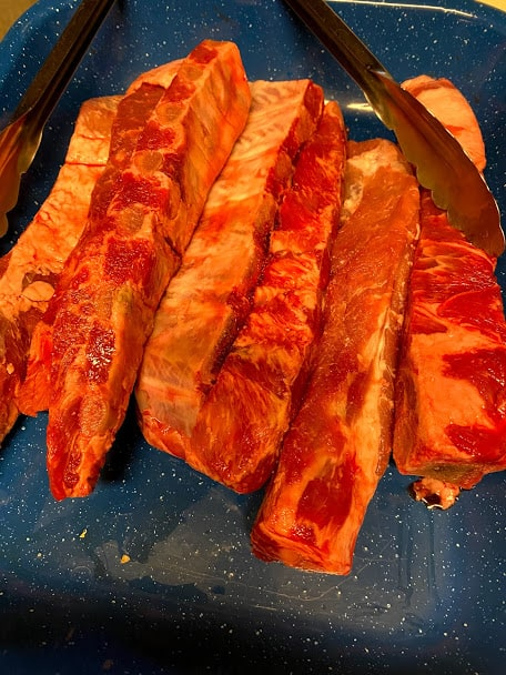 Pork ribs uncooked before slicing into smaller sections