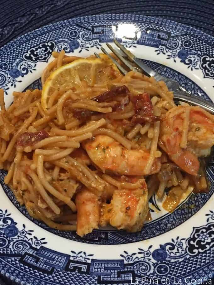 plated fideo with shrimp. fork on plate
