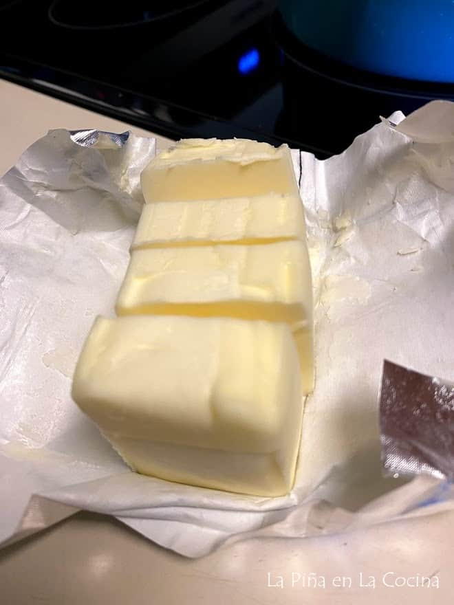 unsalted butter sliced on paper