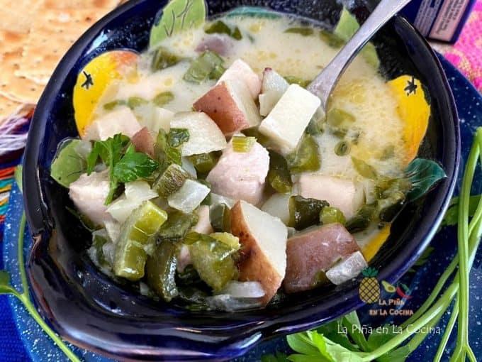 fish chowder in medium bowl with spoon