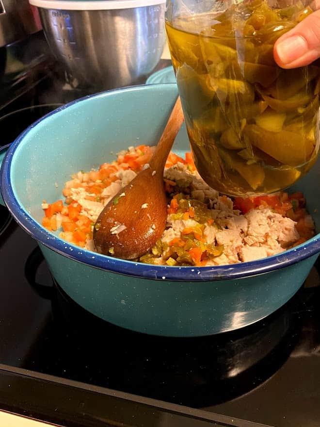 showing jar of pickled jalapeños near pot.