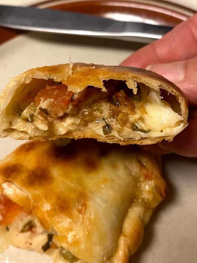empanada sliced in half to expose filling close up