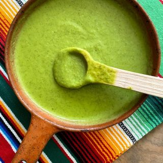 salsa verde in bowl with wooden spoon