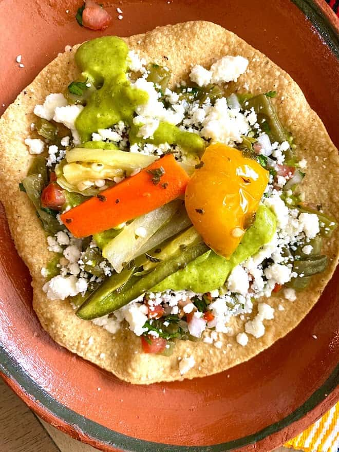 Big tostada with nopalitos, queso fresco and pickled hot pepper strips